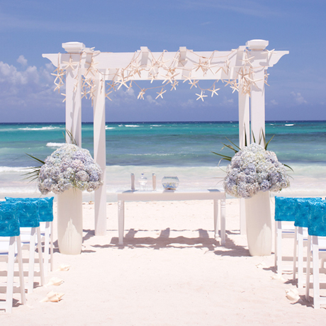 460 shutterstock_beach wedding ceremony with blue water