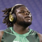 Texas defensive lineman Malcom Brown warms up for the 40-yard dash at the NFL football scouting combine in Indianapolis, Sunday, Feb. 22, 2015. (AP Photo/Julio Cortez)
