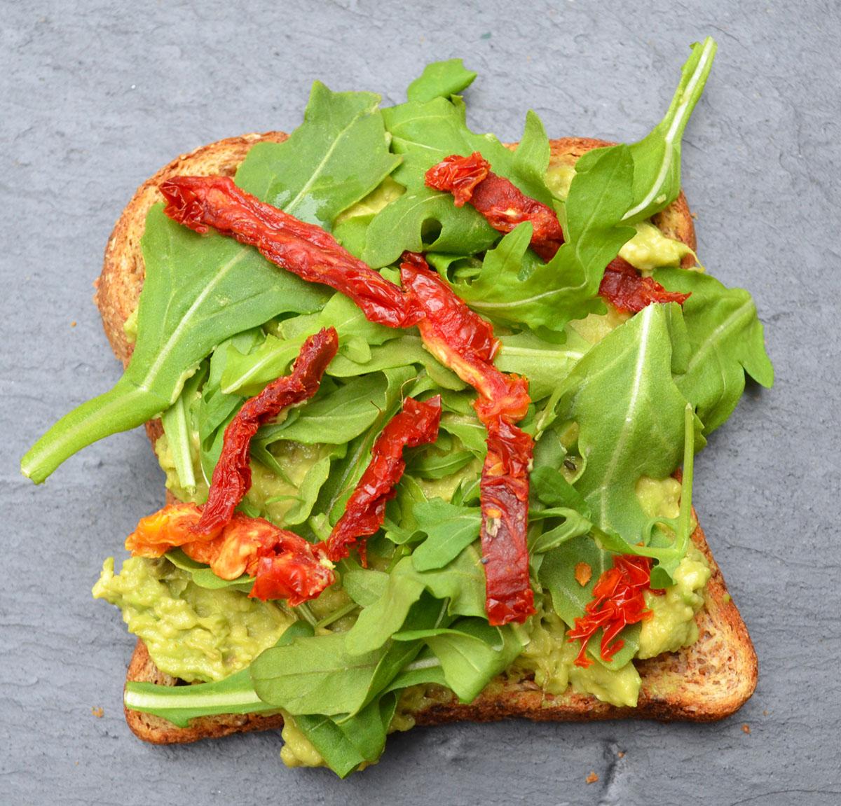 Arugula avocado toast photo via Asia Bradlee