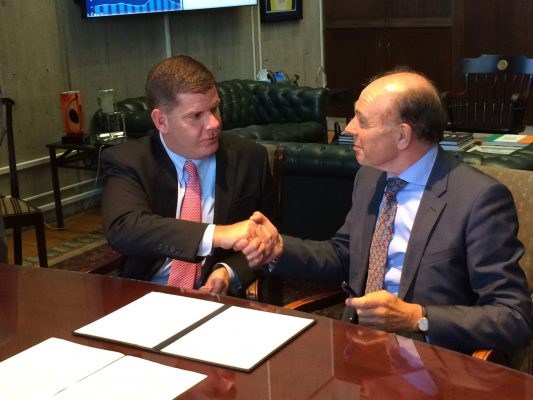 Mayor Marty Walsh and Netherlands consul general Rob de Vos shake hands after signing an agreement to cooperate on flood management Wednesday.