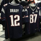 New England Patriots quarterback Tom Brady's jersey on the rack at the Olympia Sports store in Medford, Mass., Friday, Jan. 23, 2015.  The Patriots will face the Seattle Seahawks in Super Bowl XLIX on Sunday, Feb. 1, 2015, in Glendale, Ariz. (AP Photo/Charles Krupa)