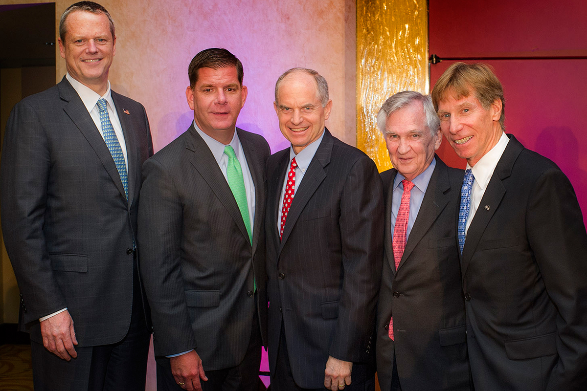 (From Left to Right) Governor of Massachusetts Charles M. Baker, Mayor of Boston Martin J. Walsh, Josh Bekenstein, managing director at Bain Capital/DFCI and PMC board member, Edward J. Benz, Jr., MD, president. Photograph at the Heavy Hitters Dinner, provided.