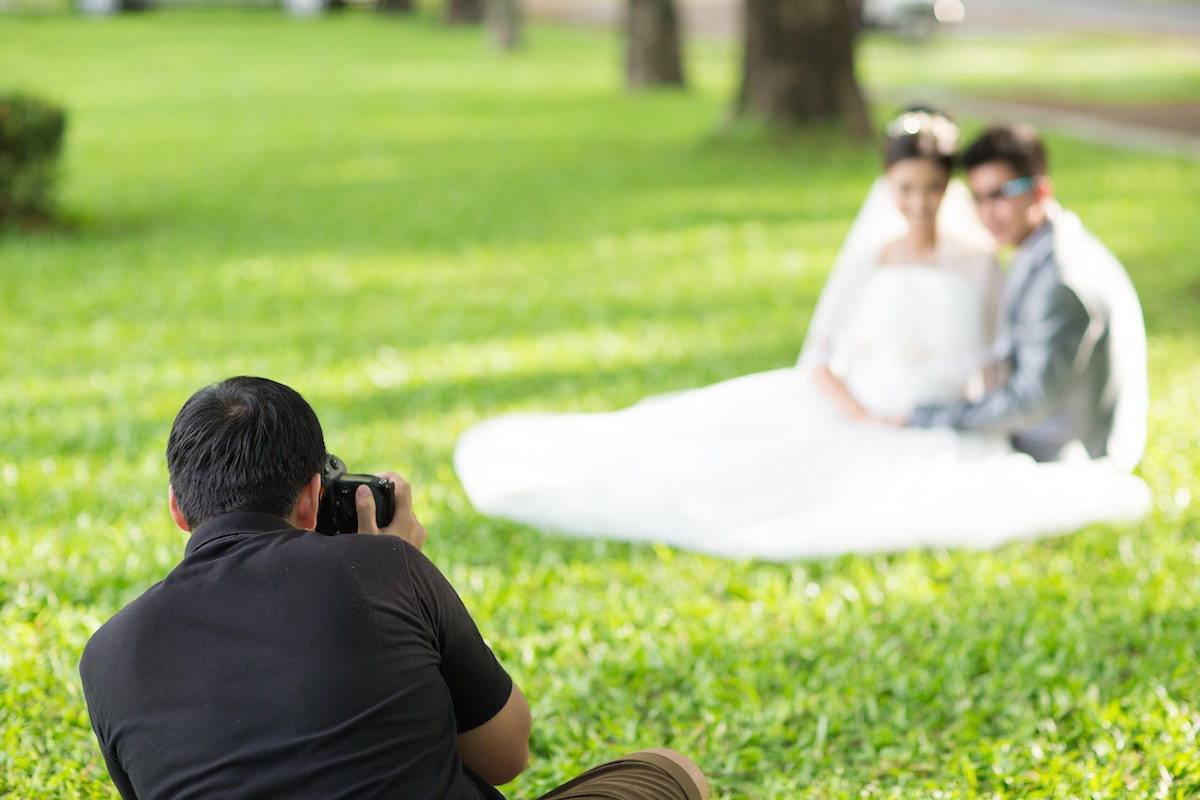 Wedding Photographer in Action via Shutterstock
