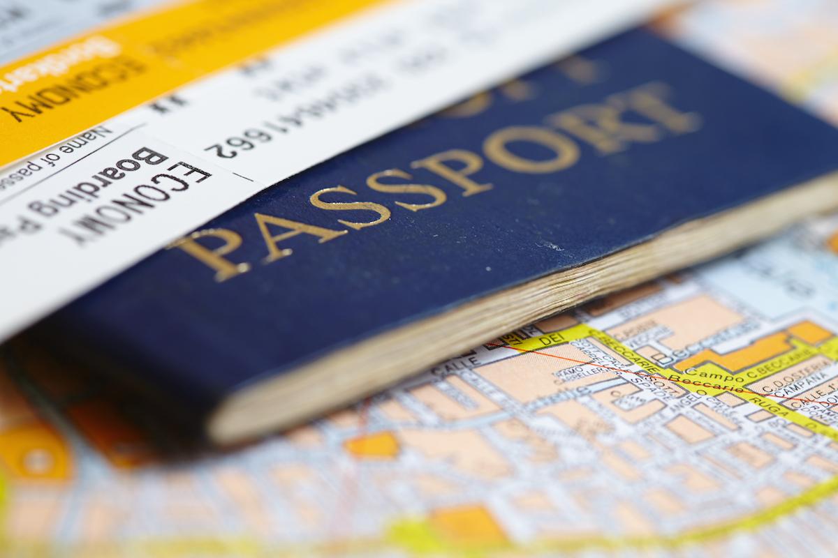 Passport on map via Shutterstock
