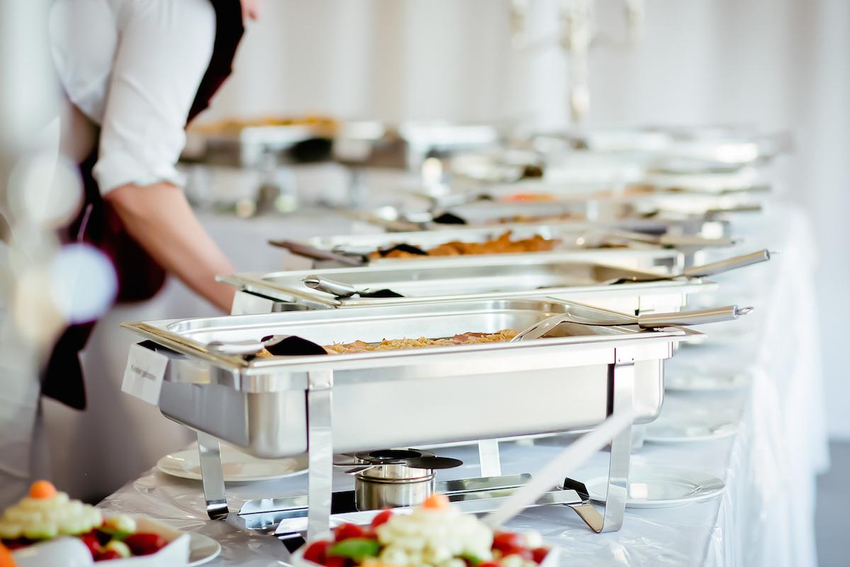 Caterer eat food wedding via Shutterstock