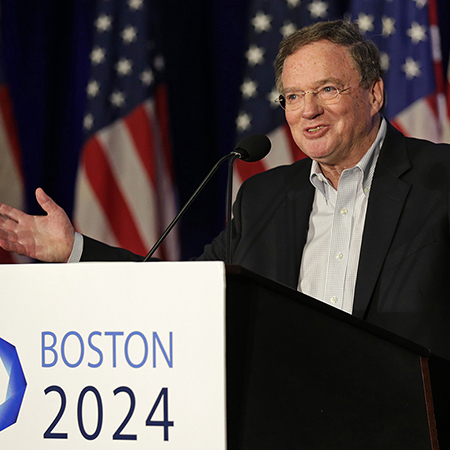 "Dan O'Connell, the president of Boston 2024, gestures during a news conference by organizers of Boston's campaign for the 2024 Summer Olympics in Boston, Wednesday, Jan. 21, 2015. The organizers released their ""bid book,"" which will give new insight into the vision behind the Games proposal. Boston was picked by the USOC as its bid city for the 2024 Olympic Summer Games. (AP Photo/Charles Krupa)"