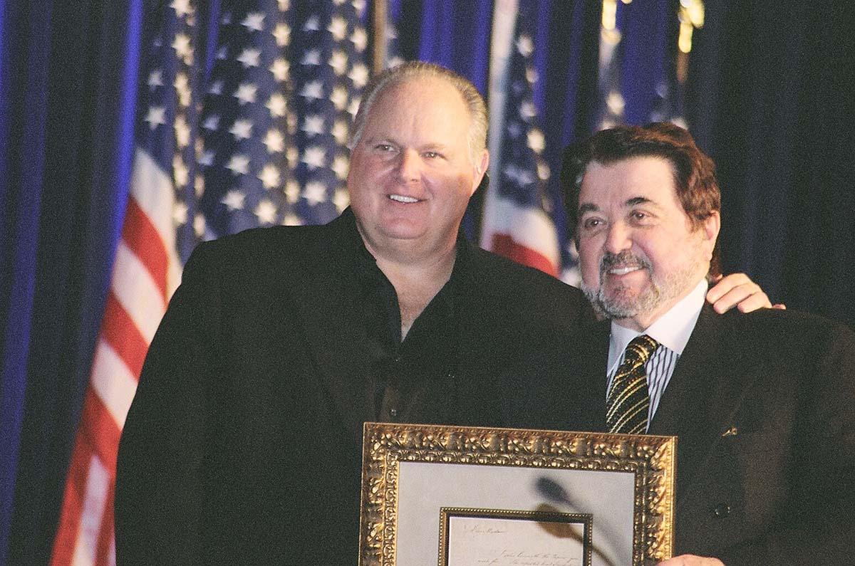 Rush Limbaugh poses with a recipient of the Rush Limbaugh award. Photo via Nicolas Shayko's Flickr,  Creative Commons