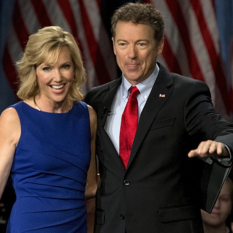 Sen. Rand Paul, R-Ky., joined by his wife Kelley Ashby, arrives to announce the start of his presidential campaign, Tuesday, April 7, 2015, at the Galt House Hotel in Louisville, Ky. (AP Photo/Carolyn Kaster)