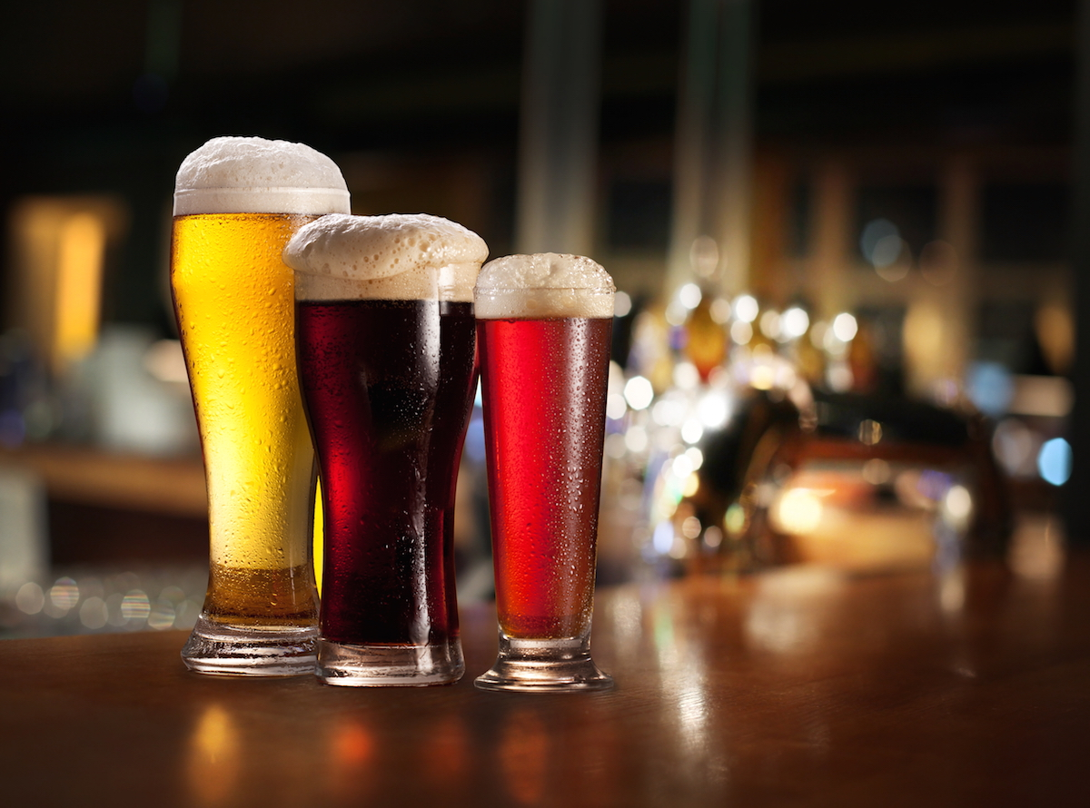 Glasses of light and dark beer on a pub background via Shutterstock