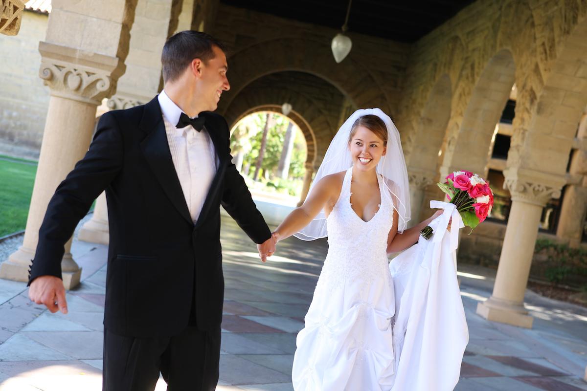 Beautiful bride and groom at church wedding via Shutterstock