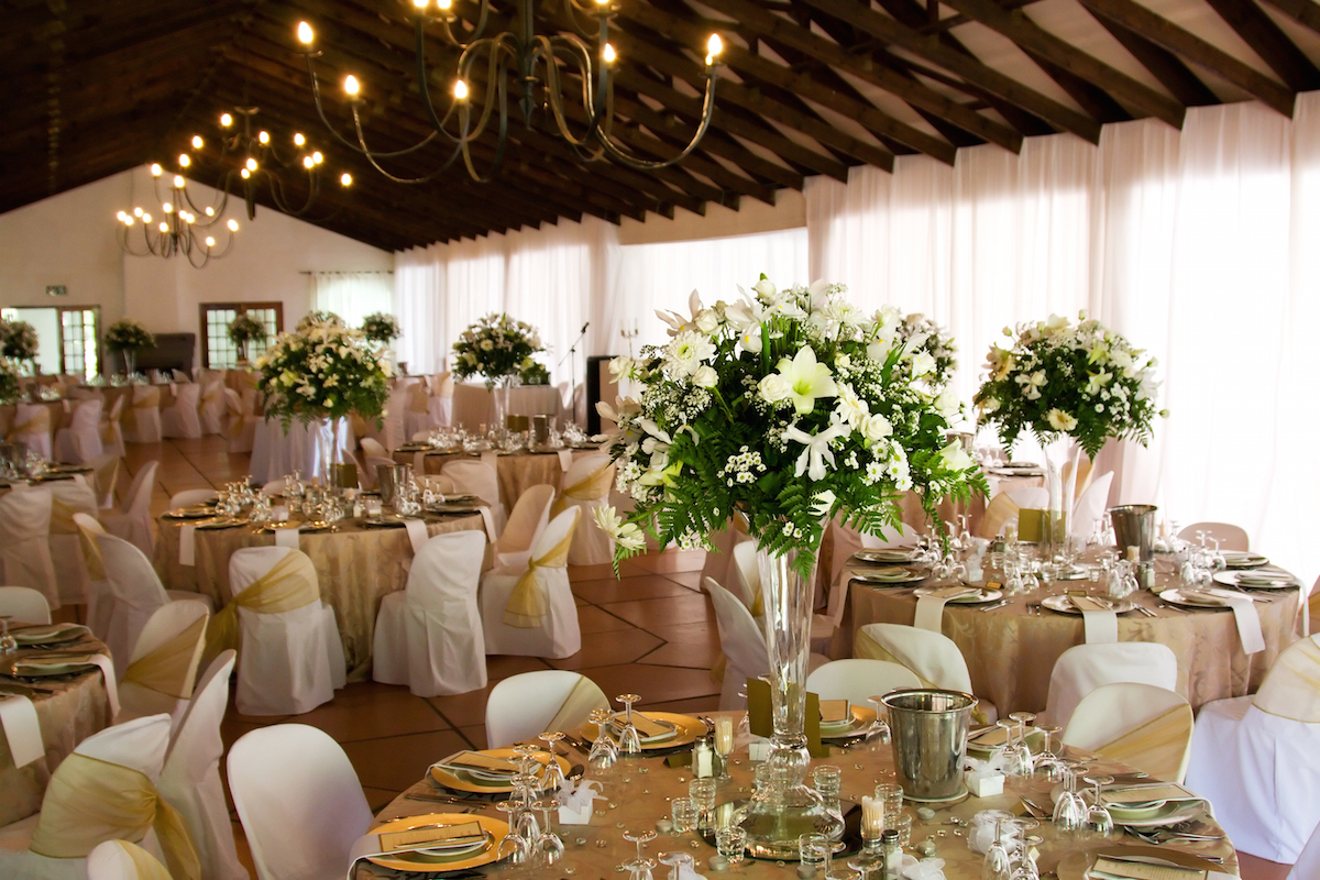 Indoor Wedding Reception With Decor Focus On Flowers Via Shutterstock