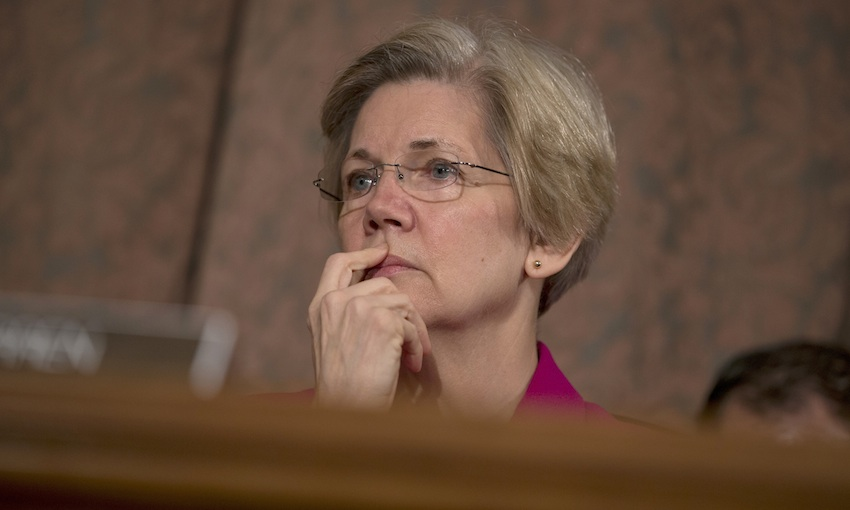 """Senate Banking Committee member Sen. Elizabeth Warren, D-Mass. listens on Capitol Hill, in Washington, Tuesday, May 21, 2013, as Treasury Secretary Jacob Lew testifies before the committee.  Lew said the Internal Revenue Service's targeting of conservative political groups was """"unacceptable and inexcusable"""" and he has directed the agency's acting director to hold people accountable.  (AP Photo/Evan Vucci)"""