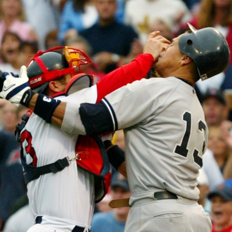Boston Red Sox catcher Jason Varitek, left, shoves New York Yankees Alex Rodriguez in the face after Rodriguez was hit by a pitch during the third inning and began yelling at Red Sox pitcher Bronson Arroyo at Fenway Park in Boston Saturday, July 24, 2004. Rodriguez and Varitek were both ejected from the game after the benches cleared.  (AP Photo/Winslow Townson)