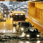 Traffic proceeds single-file through a flooded tunnel at Logan International Airport in Boston, Wednesday, Feb. 14, 2007, after snow turned to rain in the Boston area. (AP Photo/Michael Dwyer)