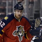 Florida Panthers' Jimmy Hayes (12) is congratulated after scoring a goal in the first period of an NHL hockey game against the San Jose Sharks, Tuesday, Nov. 11, 2014, in Sunrise, Fla. (AP Photo/Lynne Sladky)