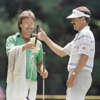 Defending U.S. Open champion Scott Simpson, Honolulu, Hawaii, hands a club to his caddie, Dan Stojak during practice for the upcoming U.S. Open at the Country Club in Brookline, Mass.,, Monday, June 13, 1988. Official play begins on Thursday. (AP Photo/Gene J. Puskar)
