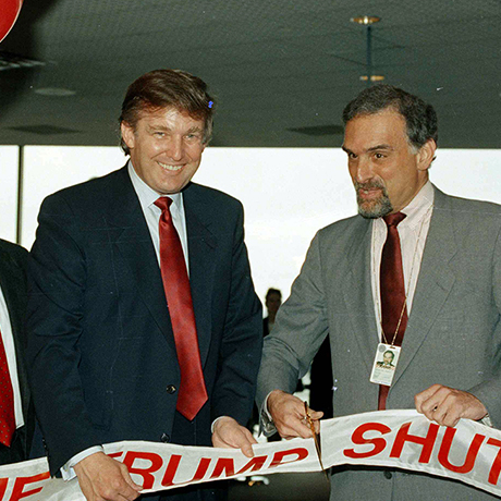 Entrepreneur Donald Trump, left, holds the ribbon on Thursday, June 8, 1989 at Logan International Airport in Boston, as Massport deputy-executive director Patrick Moscaritolo cuts it to officially open the Trump airline terminal at Logan Airport. Trump airline shuttle had it's first flight on Thursday flying from Washington to New York and then on to Boston. (AP Photo/Elise Amendola)