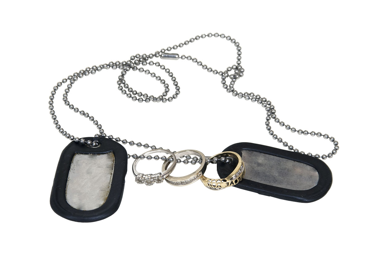 Military dog tags with wedding rings photo via Shutterstock