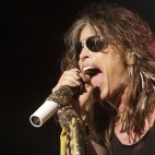 "File - Vocalist  Steven Tyler of the rock band Aerosmith performs at the Verizon Wireless Amphitheatre in this June 10, 2009 file photo taken in Maryland Heights, Mo. Tyler fell off the stage while performing the song ""Love In an Elevator"" in Sturgis South Dakota Wednesday Aug. 5, 2009. Tyler was helped backstage after the fall and was taken to the hospital after being evaluated by medical personnel. This was the first time Aerosmith had performed in Sturgis, but it was Tyler?s second appearance at the rally. (AP Photo/Jeff Roberson, File)"