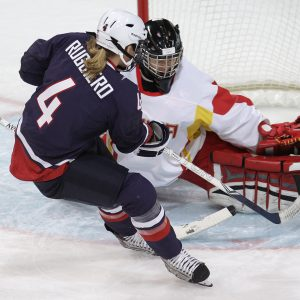 USA's defenseman Angela Ruggiero (4) scores past China's Shi goal keeper Yao (30) in women's preliminary round hockey play at the Vancouver 2010 Olympics in Vancouver, British Columbia, Sunday, Feb. 14, 2010. (AP Photo/Chris O'Meara)