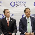 Boston 2024 Partnership Chief Operating Officer Erin Murphy, left to right, Chief Executive Office Rich Davey, Chairman and Boston Celtics co-owner Steve Pagliuca and architect David Manfredi listen to a reporter's question during a media availability after they released the updated plans for the Olympic and Paralympic games at the Boston Convention and Exhibition Center Monday, June 29, 2015, in Boston. (AP Photo/Stephan Savoia)