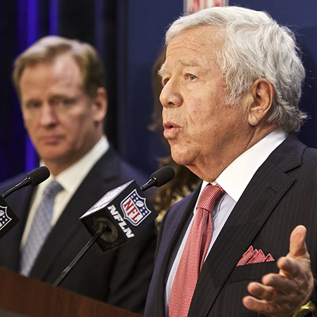 New England Patriots owner Robert Kraft  speaks at an NFL press conference announcing new measures for the league's personal conduct policy during an owners meeting, Wednesday, Dec. 10, 2014, in Irving, Texas. NFL commissioner Roger Goodell looks on at left. (AP Photo/Brandon Wade)