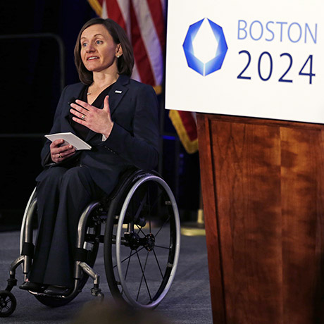 "Cheri Blauwet, co-chair of the Boston 2024 Olympic and Paralympic Movement Committee, gestures as she addresses reporters during a news conference by organizers of Boston's campaign for the 2024 Summer Olympics in Boston, Wednesday, Jan. 21, 2015. The organizers released their ""bid book,"" which will give new insight into the vision behind the Games proposal. Boston was picked by the USOC as its bid city for the 2024 Olympic Summer Games. (AP Photo/Charles Krupa)"