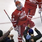 Boston University forward Jack Eichel celebrates with fans after his goal against North Dakota during the first period of a semifinal at the NCAA men's Frozen Four hockey tournament in Boston, Thursday, April 9, 2015. (AP Photo/Charles Krupa)