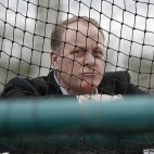 Baseball analyst and former Boston Red Sox pitcher Curt Schilling watches as infielders take batting practice at baseball spring training in Fort Myers Fla., Wednesday Feb. 25, 2015. (AP Photo/Tony Gutierrez)