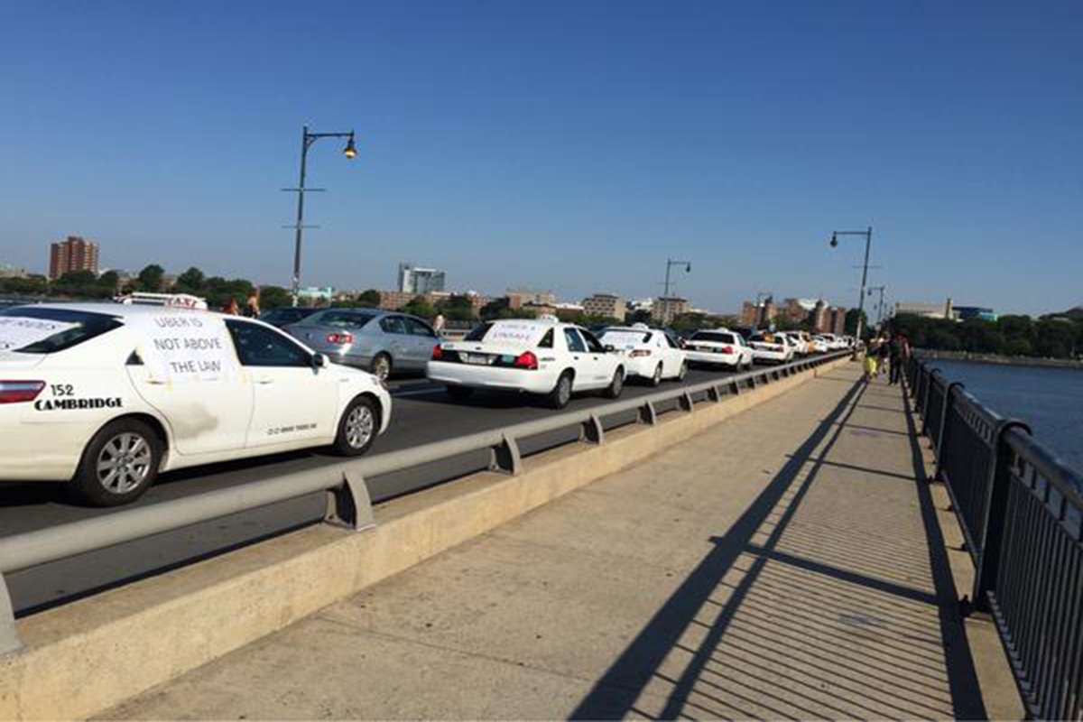 Cambridge tax cabs block traffic on the Mass Ave. Bridge. Photo by Lee McGuire