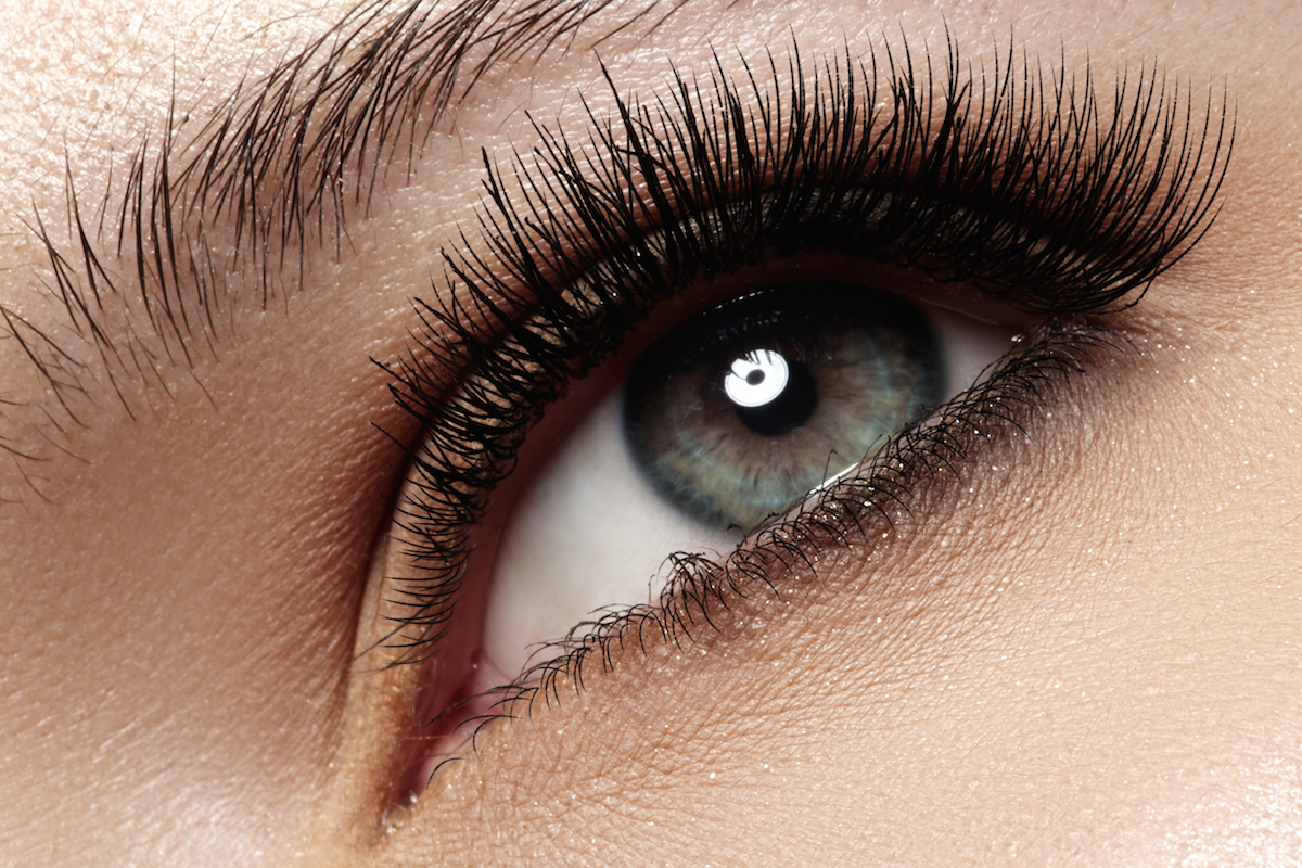 Macro shot of woman's beautiful eye with extremely long eyelashes via Shutterstock