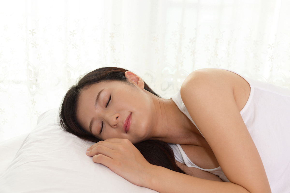 Sleeping woman via Shutterstock