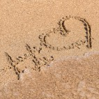460 shutterstock_Hashtag Love Heart Sign On Beach Sand