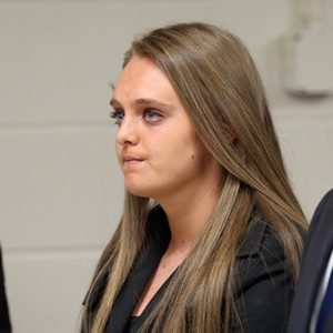 Michelle Carter stands in court with her attorneys Cory Madera, left, and Joseph Cataldo, Thursday, April 23, 2015, in New Bedford, Mass. The Bristol district attorney's office says it has no conflict of interest in the case of Carter, a Massachusetts high school student charged with encouraging a friend to kill himself. However, Carter's defense team has requested the case be moved out of Bristol County because the district attorney is the victim's third cousin. (John Wilcox/The Boston Herald via AP, Pool)