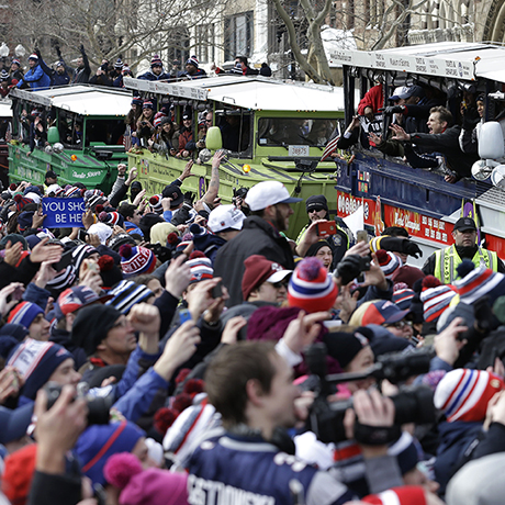 New England Patriots fans cheer as the team passes by in a procession of duck boats during a parade in Boston Wednesday, Feb. 4, 2015, to honor the Patriots' victory over the Seattle Seahawks in Super Bowl XLIX Sunday in Glendale, Ariz. (AP Photo/Steven Senne)