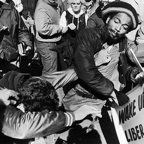 Two unidentified men mix it up in what was described as an isolated incident when the two men began fighting prior to the scheduled arrival of a Ku Klux Klan contingent which drew a crowd of demonstrators in City Hall Plaza in Boston, Saturday, Oct. 16, 1982. (AP Photo/Bill Polo)