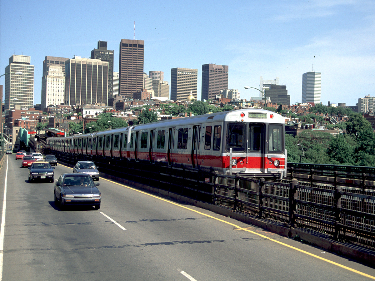 Red Line train traveling on Longfellow Bridge. Photo via Mass. Office of Tourism.