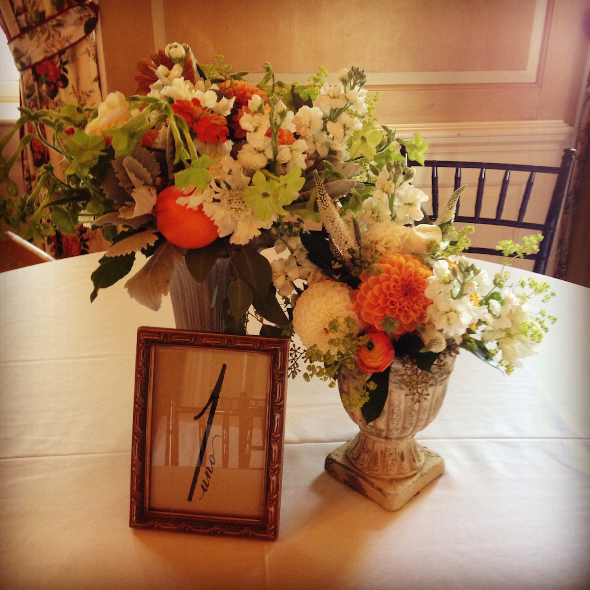 tangerines accented by stock flower, veronica, dahlias and dusty miller/Courtesy photo