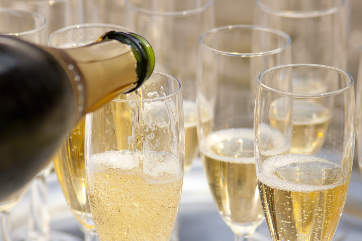 Champagne being poured into glasses via Shutterstock