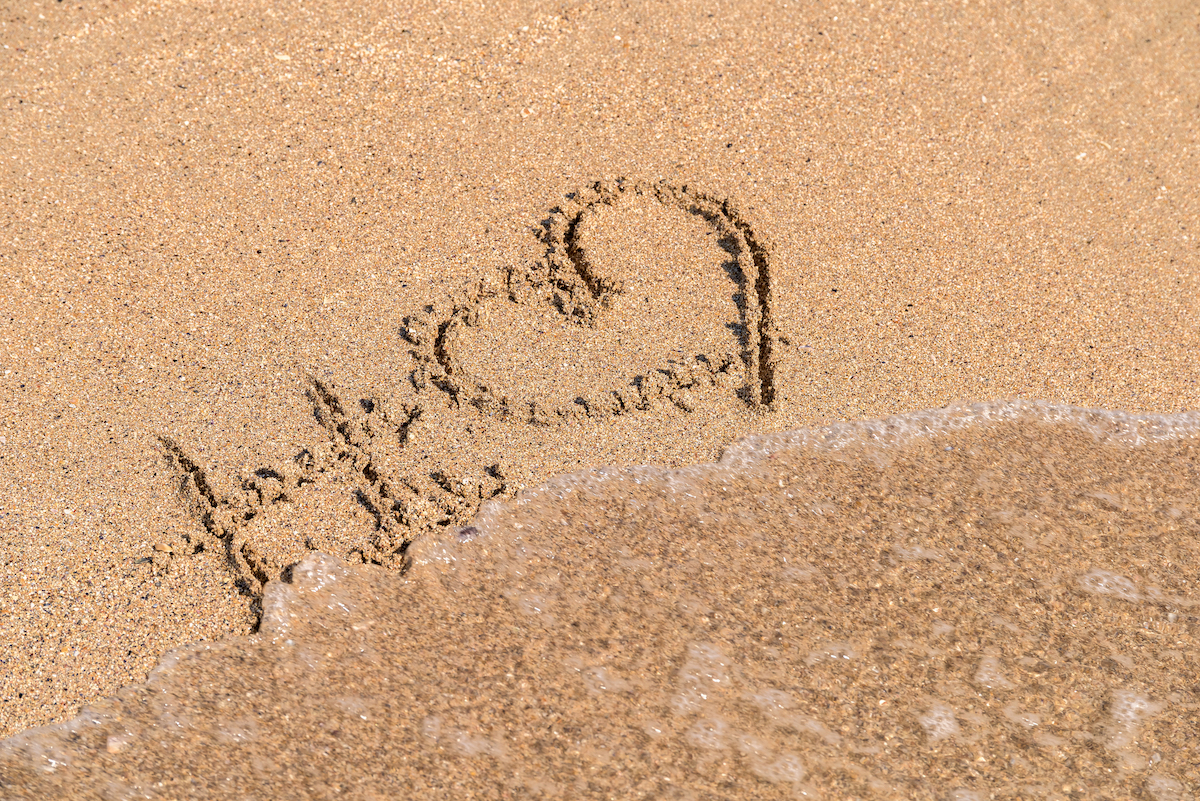 Hashtag Love Heart Sign On Beach Sand via Shutterstock