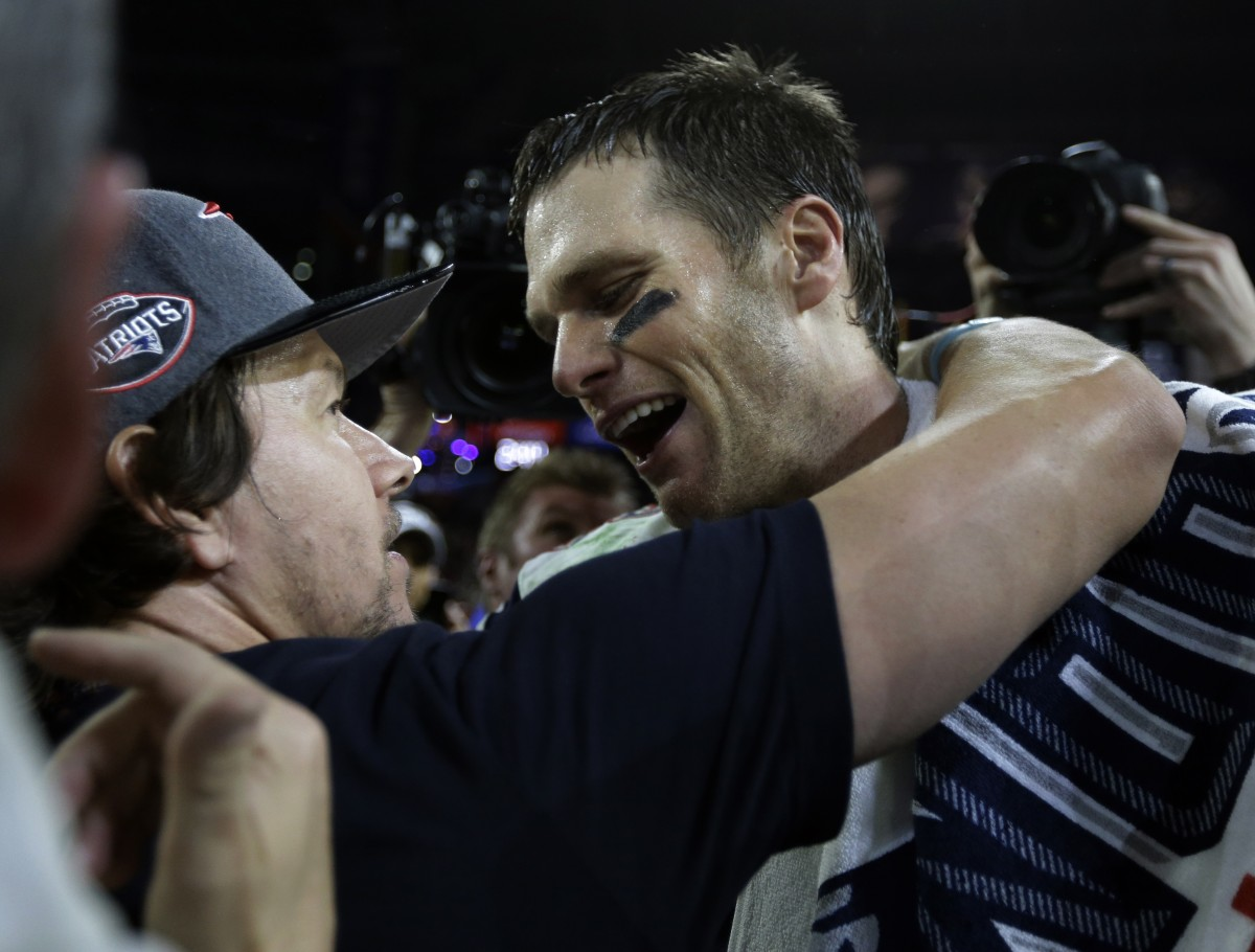 Tom Brady celebrated with Mark Wahlberg after beating the Seattle Seahawks in the Super Bowl on February 1. Photo By Ben Margot / AP