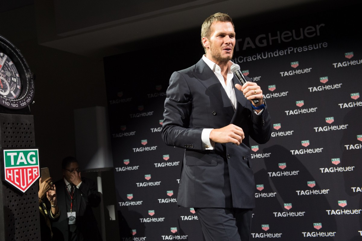 Football player Tom Brady is seen on stage at a TAG Heuer watch launch and brand ambassador announcement event at Spring Studios on Tuesday, Oct. 13, 2015, in New York. (Photo by Scott Roth / Invision / AP)