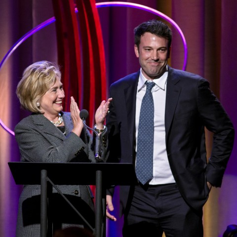 Former Secretary of State Hillary Rodham Clinton applauds actor Ben Affleck, right, during the Clinton Global Initiative's annual awards on Wednesday, Sept. 25, 2013, in New York. Clinton and Joe Biden appeared together during the event. (AP Photo/Craig Ruttle)