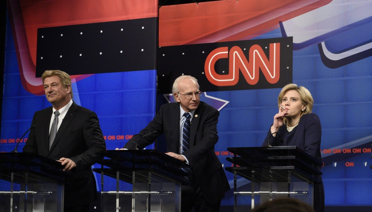 """SATURDAY NIGHT LIVE -- """"Tracy Morgan"""" Episode 1686 -- Pictured: (l-r) Alec Baldwin as Jim Webb, Larry David as Bernie Sanders, Kate McKinnon as Hillary Clinton, Taran Killam as Martin O'Malley, and Kyle Mooney as Lincoln Chafee during the """"Democratic Debate Cold Open"""" sketch on October 17, 2015 -- (Photo by: Dana Edelson/NBC)"""