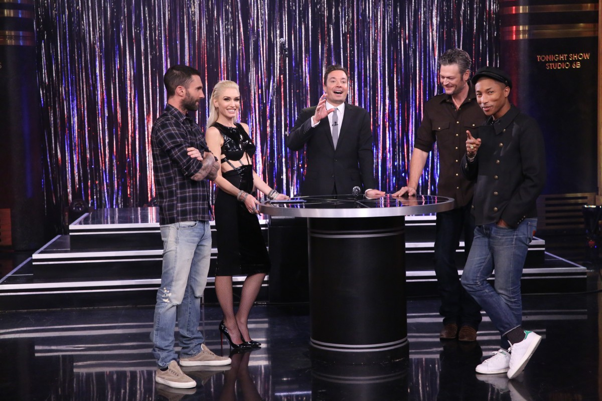 THE TONIGHT SHOW STARRING JIMMY FALLON -- Episode 0353 -- Pictured: (l-r) Singer Adam Levine, singer Gwen Stefani, host Jimmy Fallon, singer Blake Shelton, and singer Pharrell Williams play Spin the Microphone with The Voice Coaches on October 26, 2015 -- (Photo by: Douglas Gorenstein/NBC)