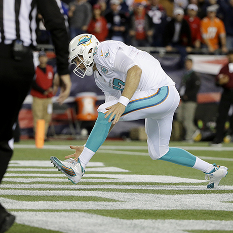 Miami Dolphins quarterback Ryan Tannehill chases a ball out of the end zone for a safety in the first half an NFL football game against the New England Patriots, Thursday, Oct. 29, 2015, in Foxborough, Mass. (AP Photo/Steven Senne)