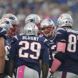 New England Patriots' Tom Brady (12) talks to his teammates in the huddle during the first quarter of an NFL football game against the Dallas Cowboys, Sunday, Oct. 11, 2015, in Arlington, Texas. (AP Photo/Brandon Wade)