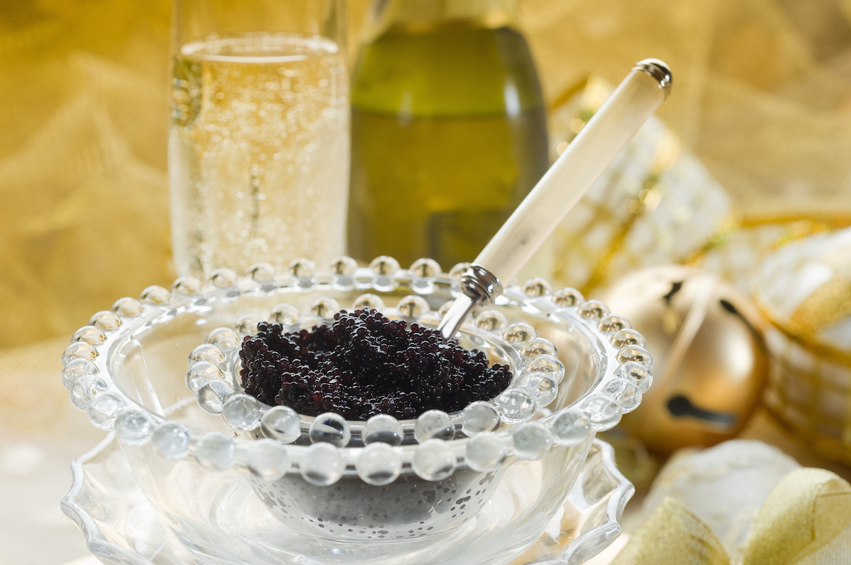 caviar and champagne over luxury table via Shutterstock