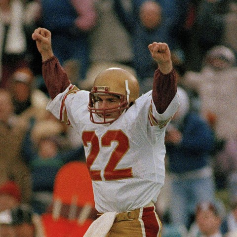 Boston College quarterback Doug Flutie (22) leaps in jubilation after a successful pass during the Cotton Bowl against the University of Houston in Dallas, Texas, Jan. 2, 1985. Boston won 45-28. (AP Photo/Carlos Osorio)