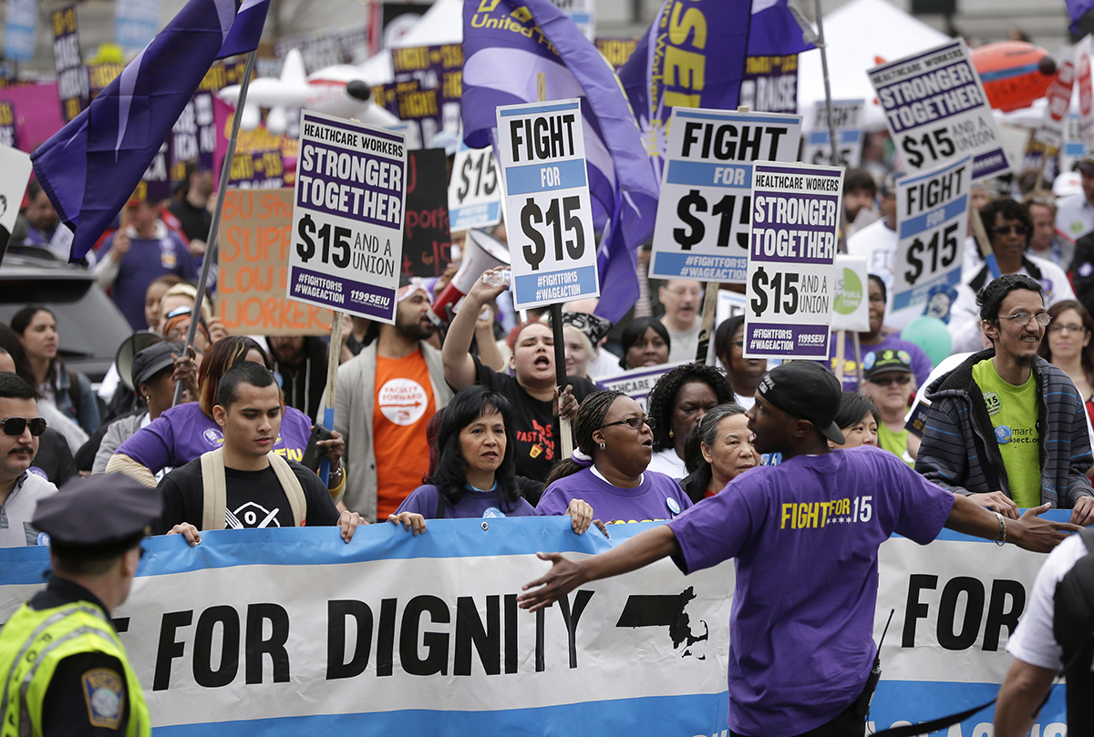 Low-wage workers and allies rally at an April march. Photo via AP